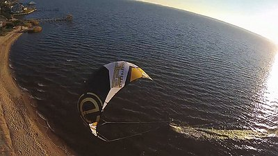 Husband and wife having an epic time kiteboarding with friends